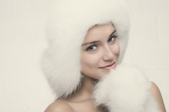 Fashion portrait of young beautiful woman posing on white backgr Royalty Free Stock Image