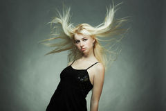 Fashion portrait of the young blonde woman royalty free stock photography