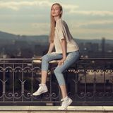 Fashion portrait of blonde woman. Jeans and sneakers. Fashion portrait of young blonde woman. Jeans and sneakers Stock Photography