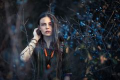 Fashion portrait of young boho girl at sunset posing on nature stock photos