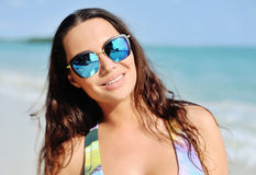 Fashion portrait young brunette girl, having vacation on the tro Royalty Free Stock Photography