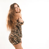 Fashion portrait of young brunette girl in leopard dress Royalty Free Stock Image
