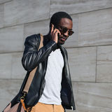 Fashion portrait young confident african man walking stock photo