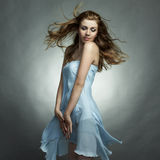 Fashion portrait of the young dancing woman. In studio royalty free stock photo