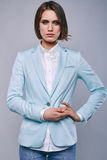 Fashion portrait of young elegant woman in azure man jacket Stock Image
