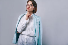 Fashion portrait of young elegant woman in azure man jacket Royalty Free Stock Photography