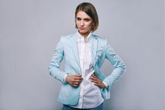 Fashion portrait of young elegant woman in azure man jacket Stock Photo