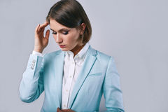 Fashion portrait of young elegant woman in azure man jacket Royalty Free Stock Images