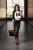 Fashion Portrait Of Young Girl With A Bag Royalty Free Stock Images