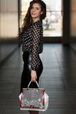 Fashion Portrait Of Young Girl With A Bag Stock Photography