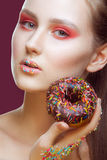 Fashion-portrait of the young girl with a donut. royalty free stock photos