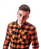 Fashion style portrait of young handsome man in the stylish red checkered shirt with interesting expression on his face royalty free stock photos