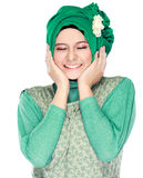 Fashion portrait of young happy beautiful muslim woman with gree. N costume wearing hijab isolated on white background stock photos