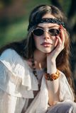 Fashion portrait of young hippie woman in sunglasses on sunny day royalty free stock photos