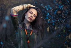 Fashion portrait of young hippie woman at sunset posing on nature stock photos