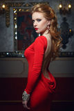 Fashion portrait of young magnificent woman in red dress Stock Images