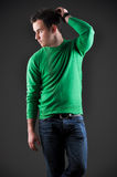 Fashion portrait of a young male model. Holding his hand over his head Royalty Free Stock Images