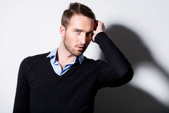 Fashion portrait of young man in black pullover. Stock Photo