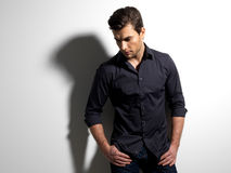 Fashion portrait of young man in black shirt Stock Photography