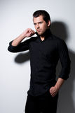 Fashion portrait of young man in black shirt . Royalty Free Stock Photos