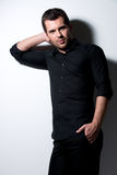 Fashion portrait of young man in black shirt . Stock Photography