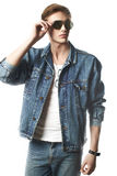 Fashion portrait of the young  man. Wearing jeans jaket Royalty Free Stock Photo