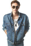 Fashion portrait of the young  man. Wearing jeans jaket Royalty Free Stock Image