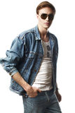 Fashion portrait of the young  man. Wearing jeans jaket Stock Photos