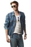 Fashion portrait of the young  man. Wearing jeans jaket Stock Photo