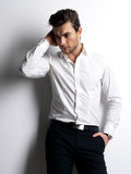 Fashion portrait of young man in white shirt Stock Image