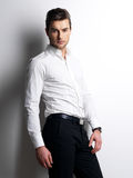 Fashion portrait of young man in white shirt stock photography