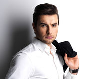 Fashion portrait of young man in white shirt Royalty Free Stock Photography