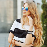 Fashion portrait young model in sunglasses Stock Images