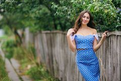 Fashion portrait of young pretty trendy girl in vintage dress po stock image