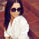 Fashion portrait of young pretty woman in sunglasses Royalty Free Stock Photo