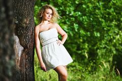 Fashion portrait of young sensual woman in garden. Royalty Free Stock Images