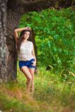 Fashion portrait of young sensual woman in garden Stock Photography