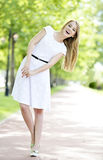 Fashion portrait of young sensual woman in garden Royalty Free Stock Photography