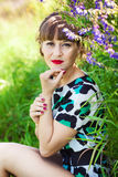 Fashion portrait of young sensual woman in garden Royalty Free Stock Photos