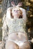 Fashion portrait of young sensual woman in garden Stock Photos