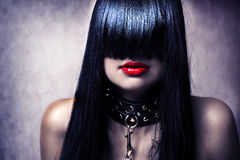 Fashion portrait of young sexy lady. Fashion portrait of young beautiful female model. Glamour woman with long black hair and sexy hairstyle. Lady with leather Stock Image