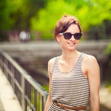 Fashion portrait of a young sexy woman wearing sunglasses Stock Images