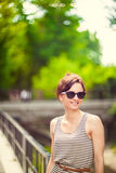 Fashion portrait of a young sexy woman wearing sunglasses Royalty Free Stock Photography