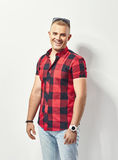 Fashion portrait of young smiling man in shirt. Fashion portrait of young smiling man in plaid shirt Stock Photography