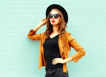 Fashion portrait young woman in black round hat, sunglasses royalty free stock photos