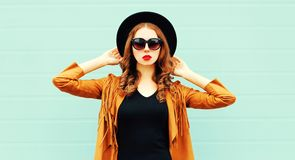 Fashion portrait young woman in black round hat, sunglasses royalty free stock image