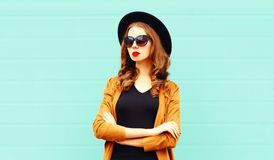 Fashion portrait young woman in black round hat, sunglasses royalty free stock images