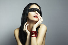 Fashion portrait of the young woman blindfold. In studio stock photos