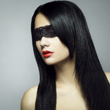 Fashion portrait of the young woman blindfold Stock Photos