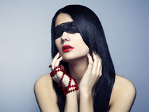 Fashion portrait of the young woman blindfold Royalty Free Stock Photos